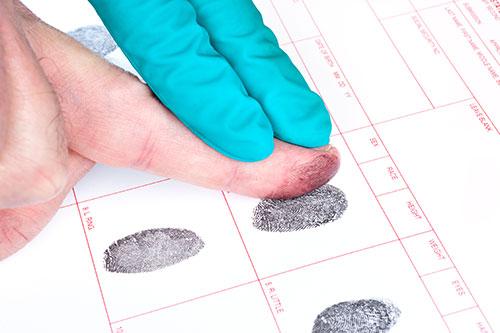 Naturalization. Biometrics Man Getting Fingerprinted